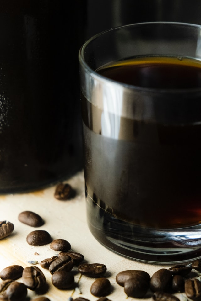 Craft Beers 2021; a glass of beer kept on a cloth with coffee beans scattered nearby