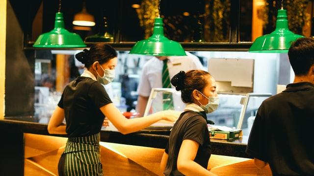 Offline Restaurant Marketing Ideas; waitresses working behind a restaurant's counter