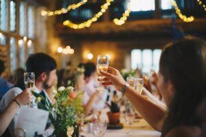 Uses of beermats; People raising their glasses to a toast in a wedding