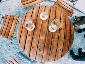Drinks placed on coasters on a round wooden table