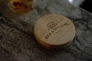 A wooden beermat with a UV varnish placed aesthetically over wood